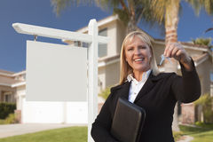 Blank Sign and Real Estate Agent Handing Over the Keys Stock Photo