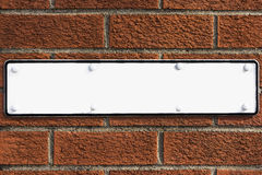 Blank sign on red brick wall Royalty Free Stock Photos