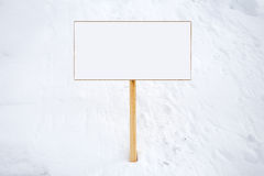 Blank sign in the snow Stock Images