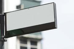 Blank sign on a street corner Stock Images