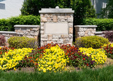 Blank sign of the subdivision entrance. With flowers and landscaping Royalty Free Stock Image