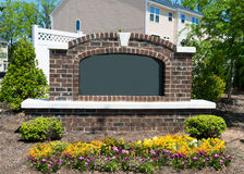 Blank sign of the subdivision entrance. With flowers and landscaping Stock Photos