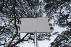 Blank sign with trees above Royalty Free Stock Photos