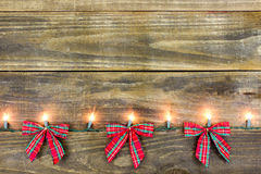 Blank Sign With Red And Green Bows And Holiday Lights Royalty Free Stock Photos