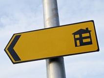 Blank sign. Blank yellow sign pointing in direction where to buy new houses Royalty Free Stock Image