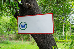 Blank signboard with butterfly symbol Royalty Free Stock Photo