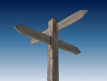 Blank signpost. Old wooden blank signpost on blue background Royalty Free Stock Photo