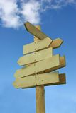 Blank signpost. Blank wooden direction signpost against a blue sky Stock Photography