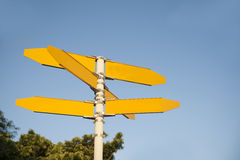 Blank signpost. Consisting five yellow pointers ready for you adding of text stock photos