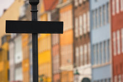Blank signpost. In front of Copenhagen colorful facades (Denmark Stock Images