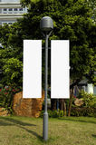 Blank signpost on lamppost Royalty Free Stock Photography