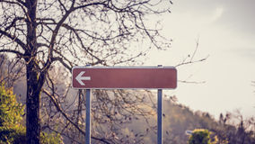Blank signpost with left pointing arrow Royalty Free Stock Image