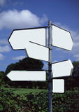 Blank signposts. Multi directional signposts blanked out Stock Photo