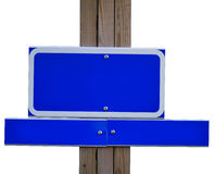 Blank signs. Blank blue metal signs on wooden pole isolated on white background royalty free stock photos