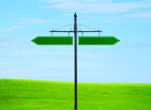 Blank signs pointing in opposite directions. Symbolising decision making, crossroads, business guidance and opportunity Stock Photography