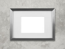 Blank silver picture frame on the wall Stock Photography
