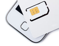 Blank sim card with smart phone Royalty Free Stock Photos