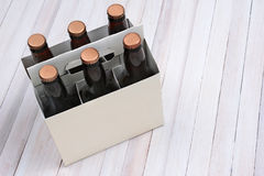 Blank Six Pack on Wood Table Stock Photo