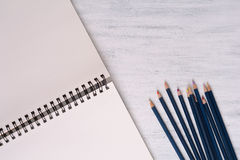 Blank sketchbook with color pencils Royalty Free Stock Photo