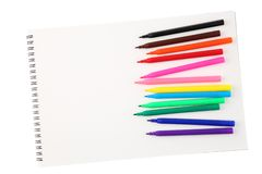 Blank sketchbook with empty space for text and left opened colorful felt tip pens isolated on white background. Art and creativity. Concept royalty free stock photos