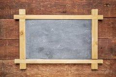 Blank slate blackboard against wood Royalty Free Stock Photos