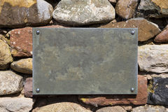 Blank Slate Sign on Stone Wall Royalty Free Stock Photography