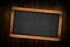 Blank Slate on Wooden Background Royalty Free Stock Photography
