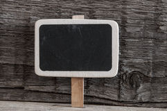 Blank small black chalkboard on wood background Royalty Free Stock Image