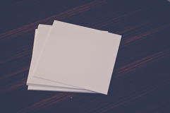Blank small papers. On wooden table Royalty Free Stock Image