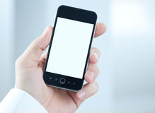 Blank smart phone in hand Royalty Free Stock Photo