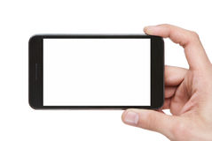 Blank smart phone in hand Royalty Free Stock Images
