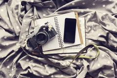 Blank smartphone screen with diary, old style photo camera and b Royalty Free Stock Photo