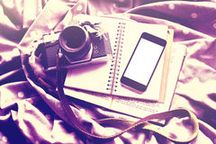 Blank smartphone screen with diary, old style photo camera and b Stock Photos
