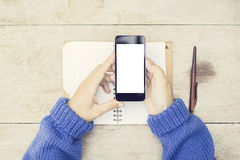 Blank smartphone screen with woman hands, blank diary and pen, m Royalty Free Stock Image