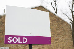 Blank SOLD sign outside the side of a building Royalty Free Stock Photo