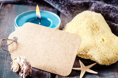 Blank Spa Tag with yellow sponge and blue candlelight Royalty Free Stock Image