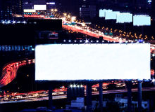 Blank space billboard at night with city traffic and car light as background, ready for advertisement Stock Photography
