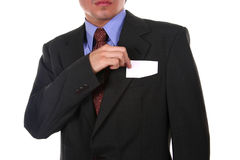Blank space II. Businessman taking a blank business card out of his pocket Royalty Free Stock Image