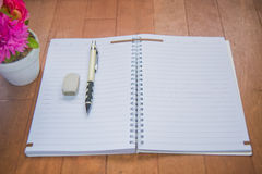 Blank space of notepad. With supplies and flower. Top view with copy space royalty free stock image