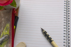 Blank space of notepad. With supplies and flower. Top view with copy space stock photos