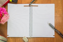 Blank space of notepad. With supplies and flower. Top view with copy space stock photography