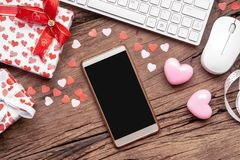 Blank space smartphone mock up template for Valentine`s day internet online shopping concept. Flat lay top view with heart shapes royalty free stock photos