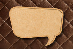 Blank Speech Bubble on Brown leather Stock Images