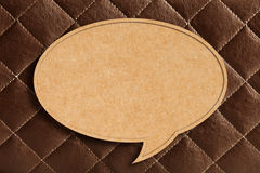 Blank Speech Bubble on Brown leather Royalty Free Stock Images