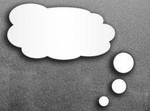 Blank speech bubble on gray background. Stock Images