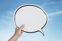 Blank speech bubble in hand stock image