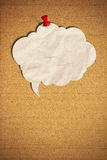 Blank speech bubble with push pin on cork board Royalty Free Stock Images