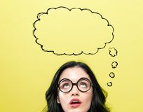 Blank speech bubble with young woman. Wearing eye glasses royalty free stock images