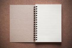 Blank spiral binder notebook. On wooden background Stock Photo