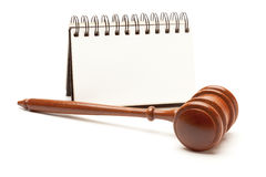 Blank Spiral Note Pad and Gavel on White. Stock Photo